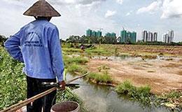 Tình trạng cưỡng chế thu hồi đất cho những dự án kinh tế vẫn chưa có dàn xếp thỏa đáng với người dân. Courtesy taichinh.vn