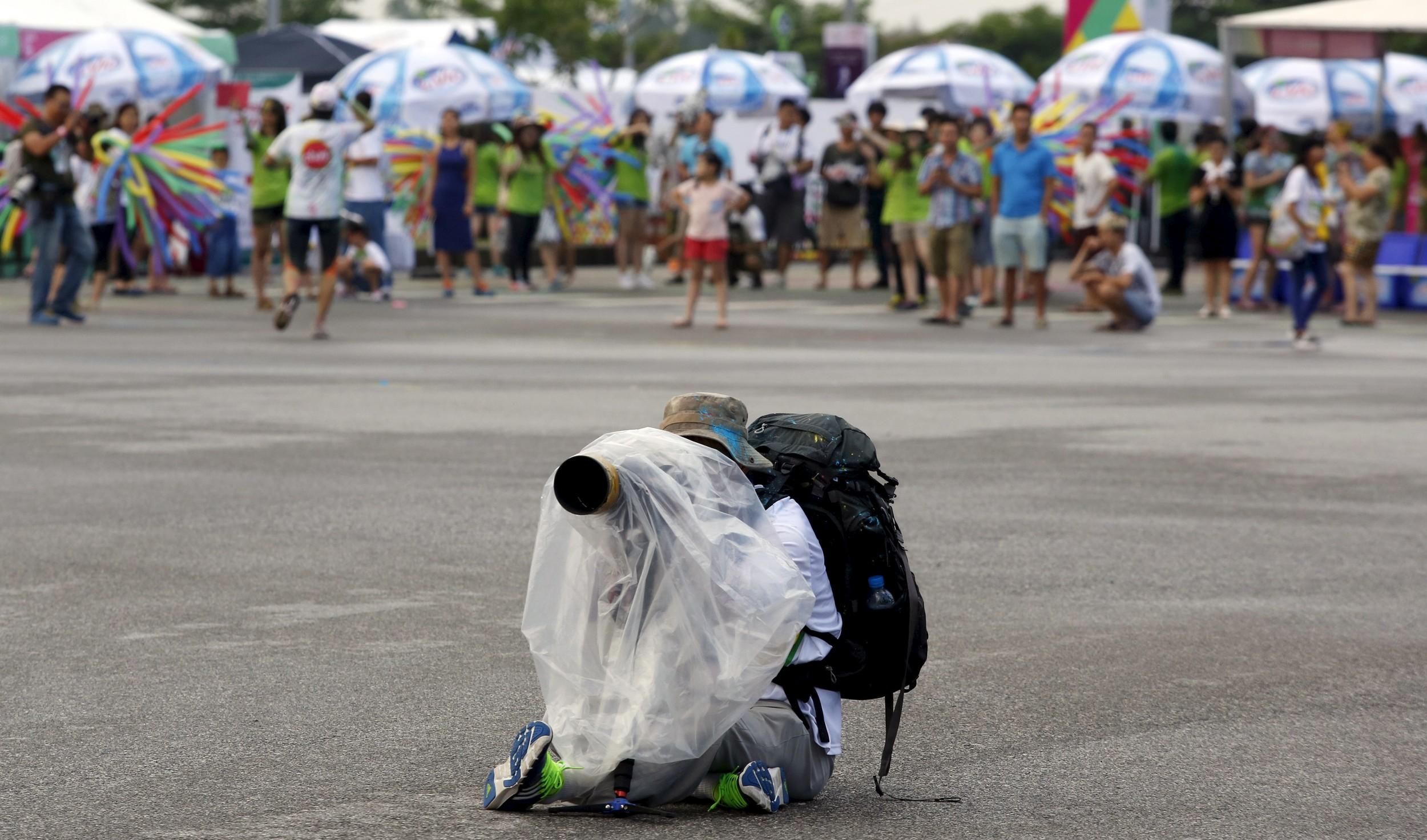 Phóng viên chụp ảnh ở Hà Nội hôm 26/9/2015.