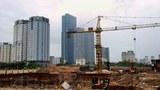 Hình minh hoạ. Các toà nhà đang được xây dựng làm khu dân cư và văn phòng ở Hà Nội năm 2013