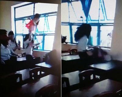 Hình ảnh Em Phượng, học lớp 7 ở trường THCS Lý Tự Trọng, tỉnh Trà Vinh bị đánh hội đồng. Ảnh chụp từ video clip.