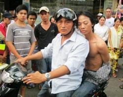 Một tên cướp giật vừa bị bắt. Photo courtesy of vietnamnet