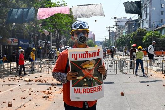 Reuters-protester-poster-Senior-General-Min-Aung-Hlaing-20210309-Yangon.jpg