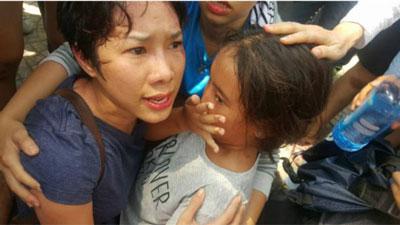 Người biểu tình có con nhỏ cũng bị đánh.