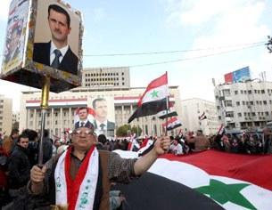 Phe ủng hộ Chính phủ Al Assad tổ chức biểu tình rầm rộ ở Damascus, ngày 26/01/2012 nhân Liên đòan Ả Rập hôm nay tiếp tục công tác giám sát .