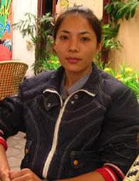Cô Trần Thị Huệ bắt đầu uống thuốc ARV 3 năm sau khi nhiễm HIV. Photo courtesy of phapluat.vn