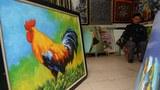 Một bức tranh sơn dầu hình con gà trống được bày bán trong một cửa hàng ở Hà Nội ngày 20 tháng 1 năm 2017.