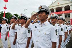 Hải quân Trung Quốc trong lễ bổ nhiệm các quan chức cho cái gọi là TP Tam Sa. AFP photo