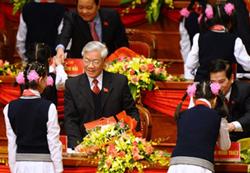 Chủ tịch Quốc Hội Nguyễn Phú Trọng tại phiên khai mạc Đại hội Đảng lần 11 hôm 12/1/2011. AFP photo