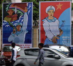 Các pano tuyên truyền trên đường phố Hà Nội. AFP photo