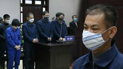 Ông Hoa Hữu Long và đồng phạm tại phiên toà.
