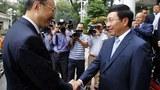 Phó Thủ tướng Việt  Nam kiêm Bộ trưởng Bộ Ngoại giao Phạm Bình Minh chào đón Ủy viên Quốc vụ Trung Quốc Dương Khiết Trì tại Bộ ngoại giao ngày 27 Tháng Mười 2014.