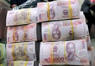 Tiền đồng Polymer của Việt Nam, ảnh chụp tại Hà Nội hôm 28/02/2008.
